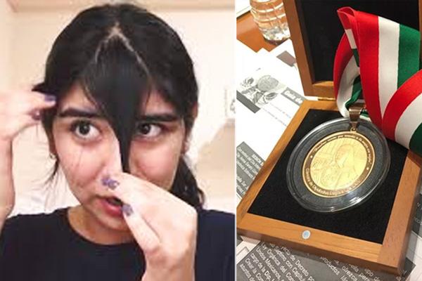 Mujeres que logren cortarse el fleco por sí solasrecibirán medalla al mérito
