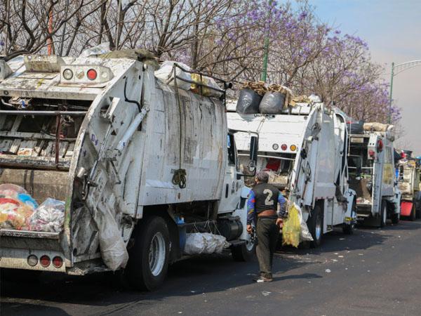 Recibirán beca de Conade los que siempre corran tras el camión de la basura