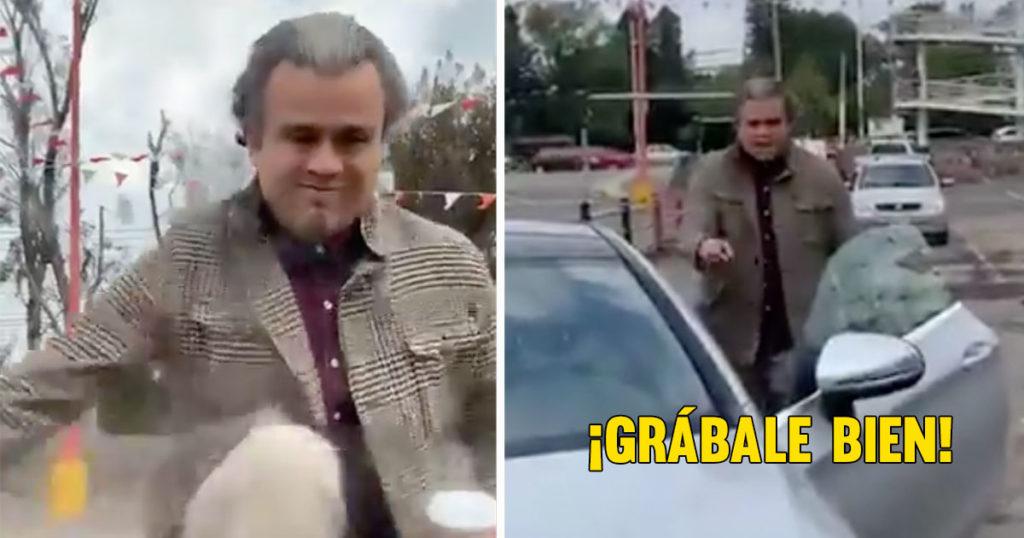 LordCafé: Este pobre diablo no aguantó un golpecito en el coche y se puso a dar patadas