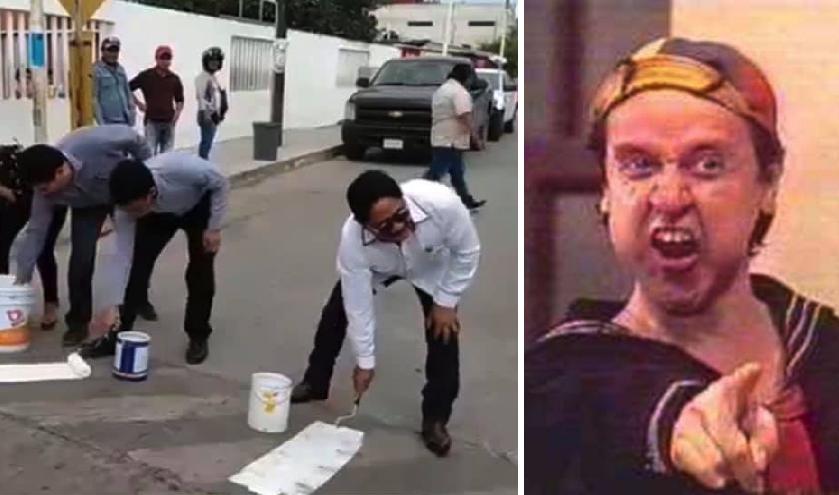 Momento exacto en el que un político pinta al revés las rayas del cruce peatonal
